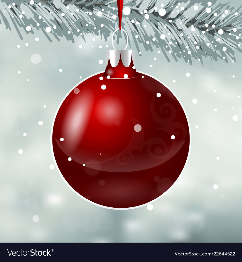 Red christmas toy on snowfall background