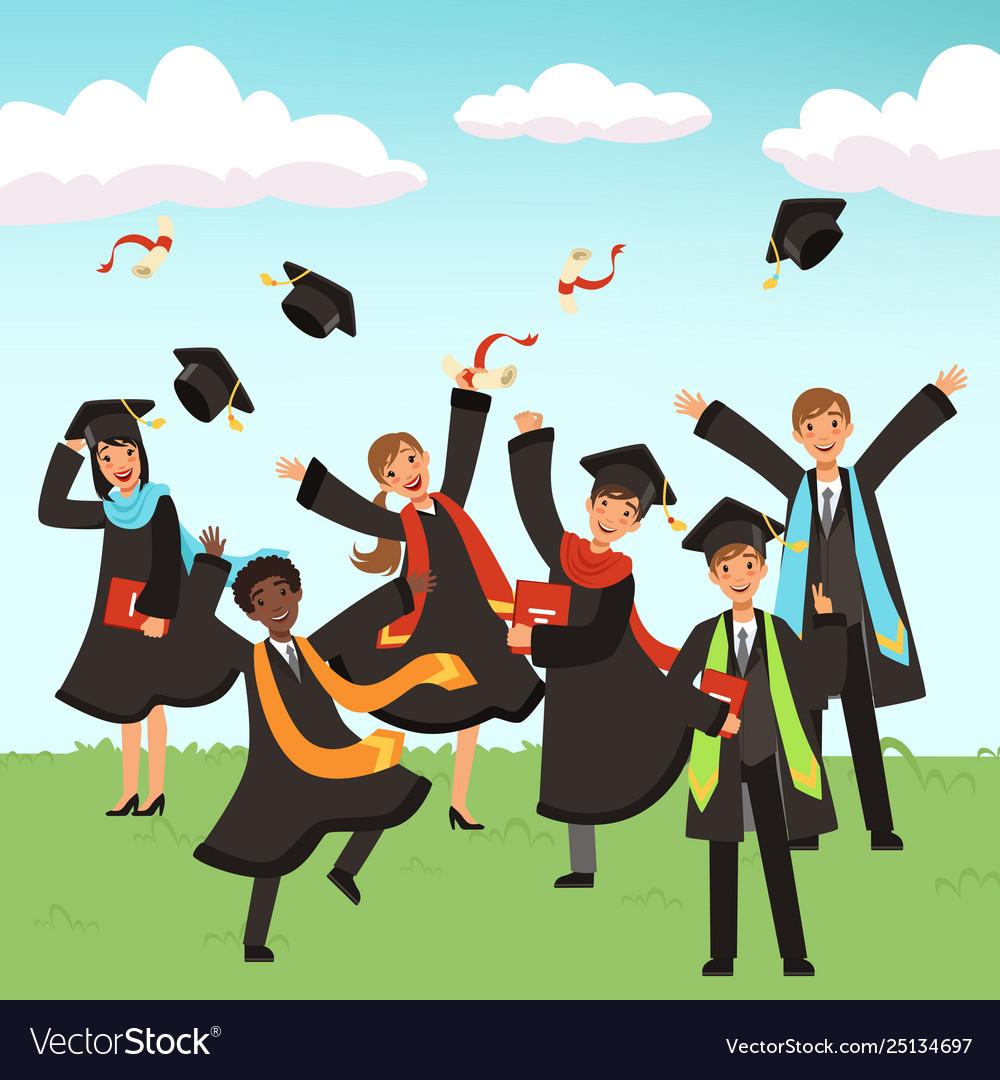 Happy international graduates with diplomas and