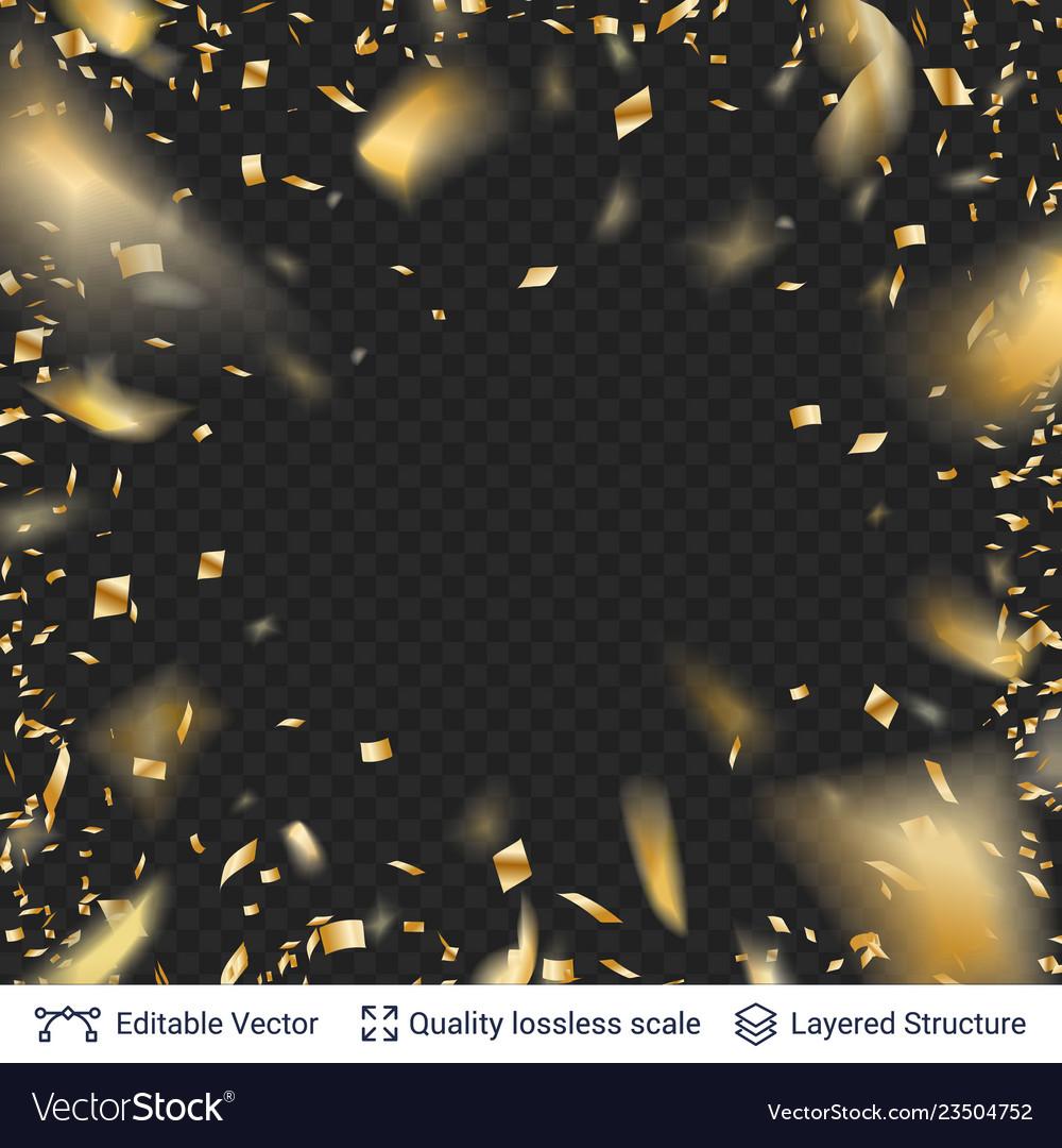 Golden festive tinsel confetti blurred in motion
