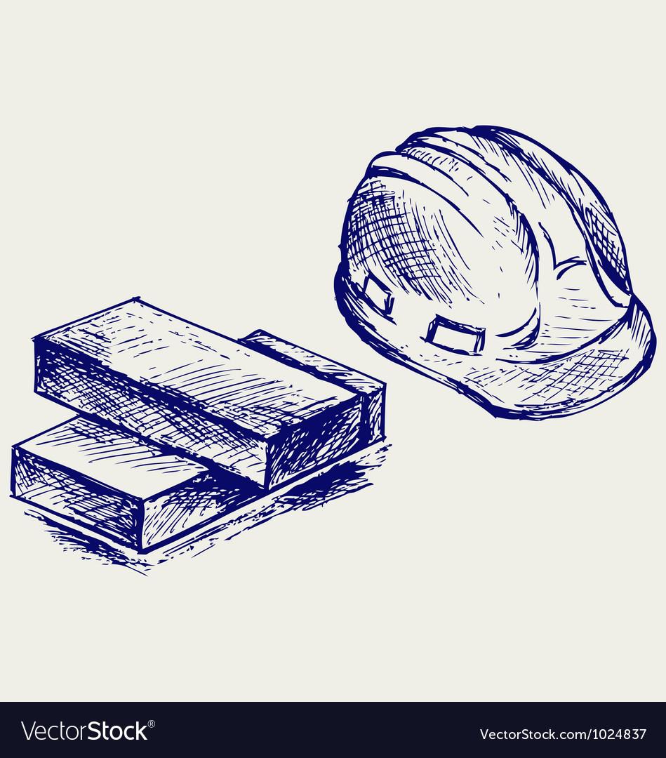 Hard hat and bricks