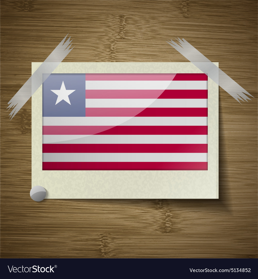 Flags Liberia at frame on wooden texture