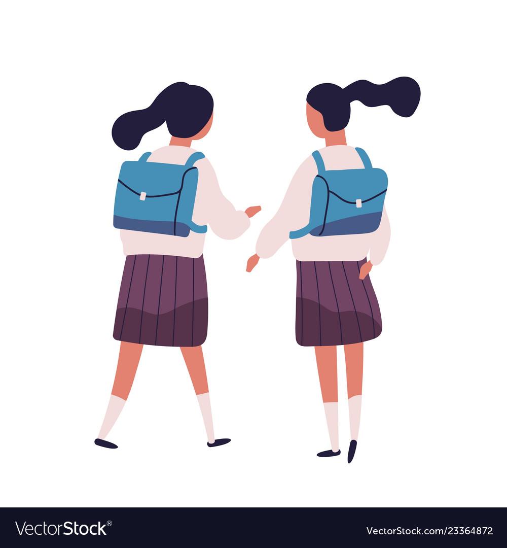 Pair of girls or twin sisters dressed in school