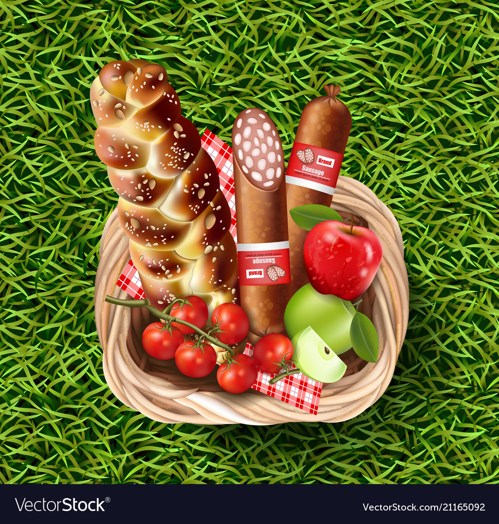 Basket full of food products on green grass