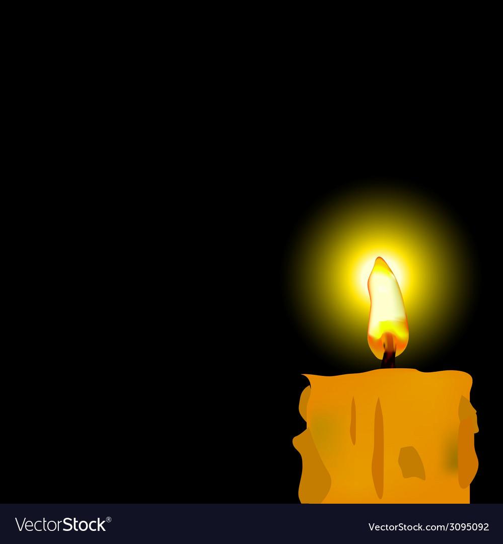 Burned candle on black background