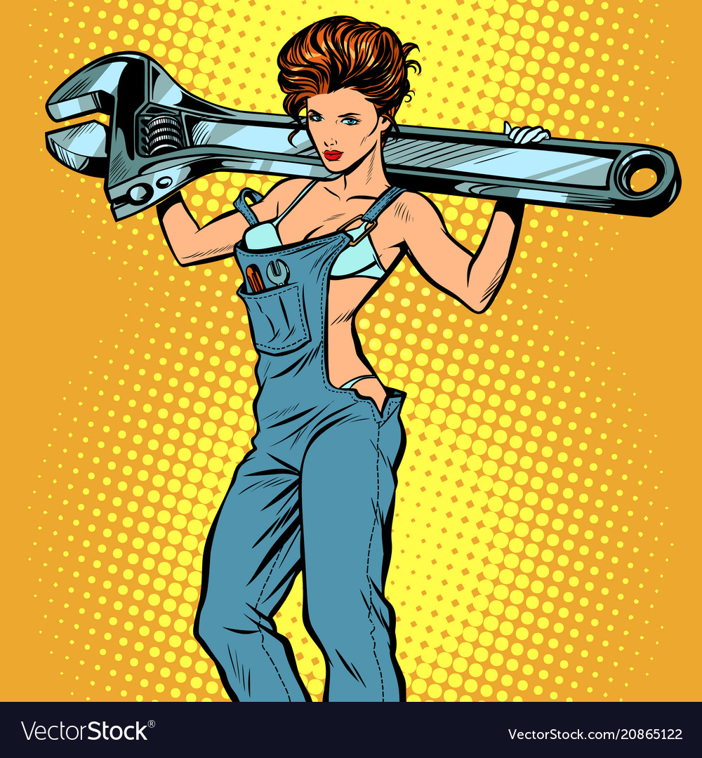 Sexy woman in work overalls with a wrench