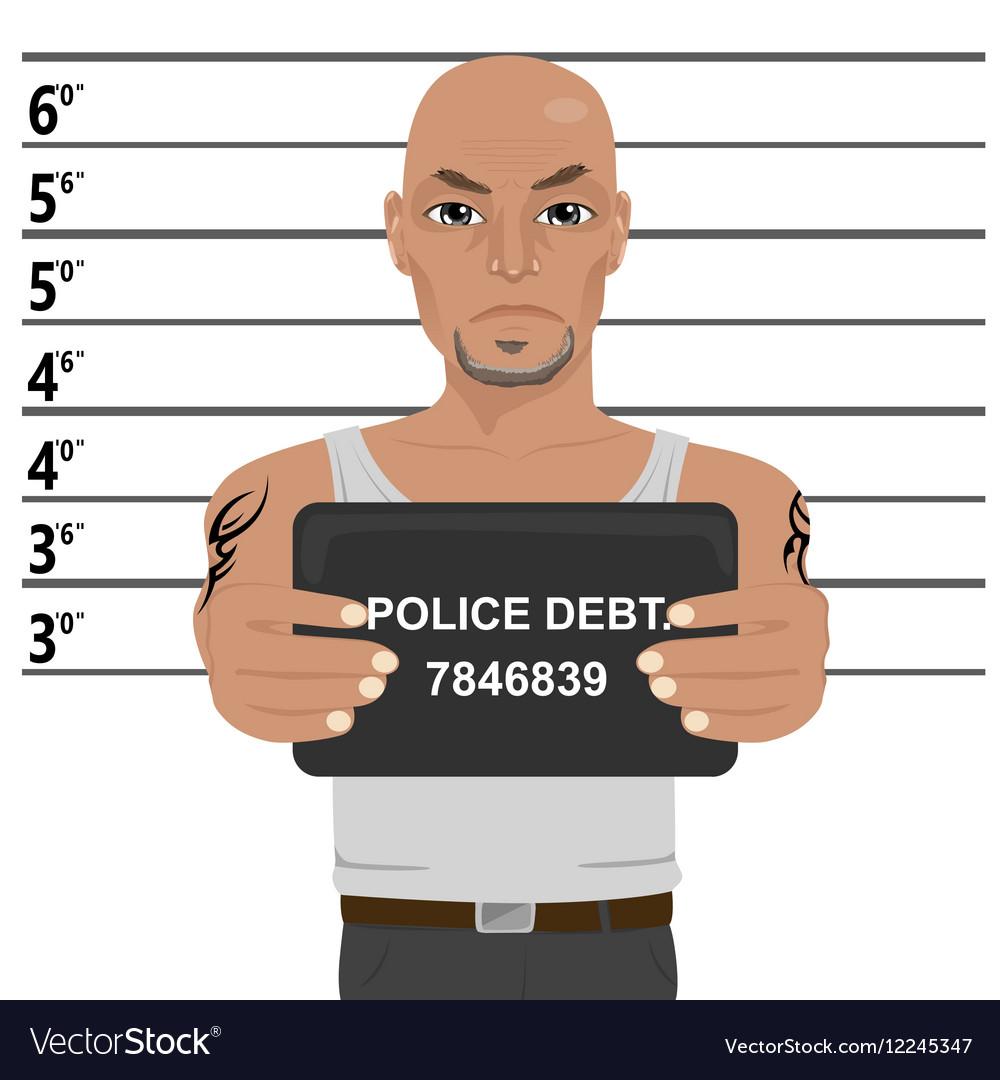 Latino gangster with tattoos holding mugshot