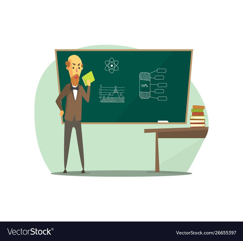 Professor standing in front blackboard with