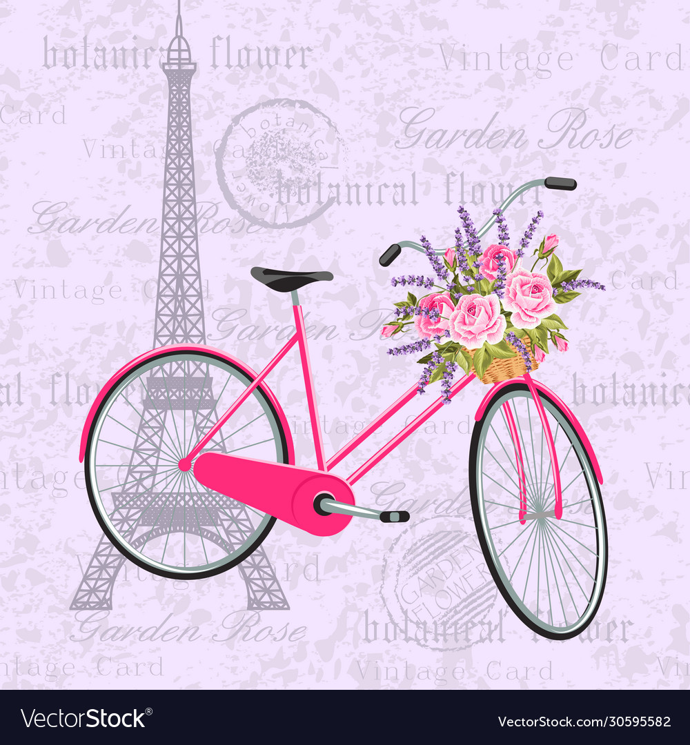 Pink bicycle with a basket full flowers