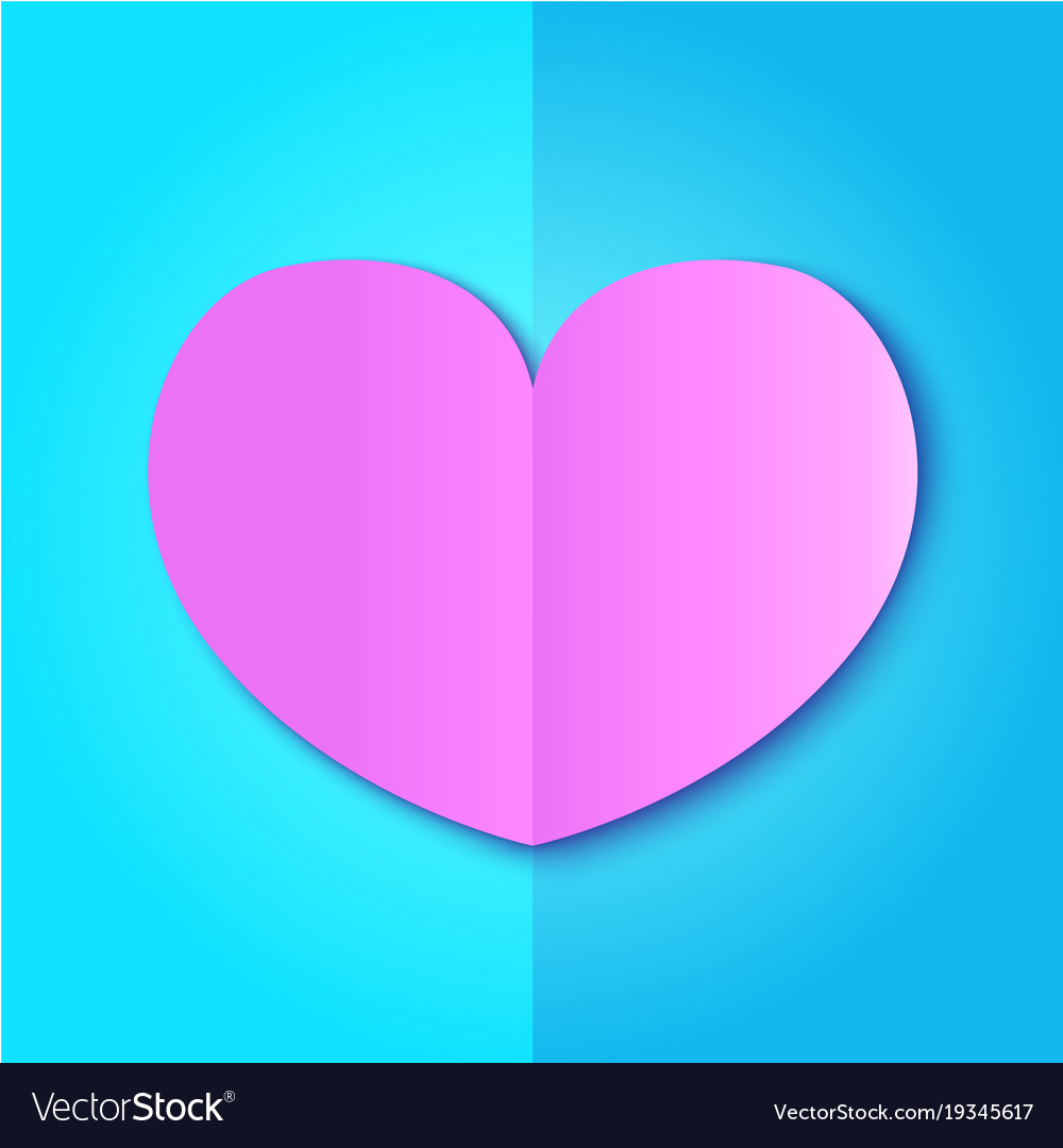 Pink paper heart on blue background