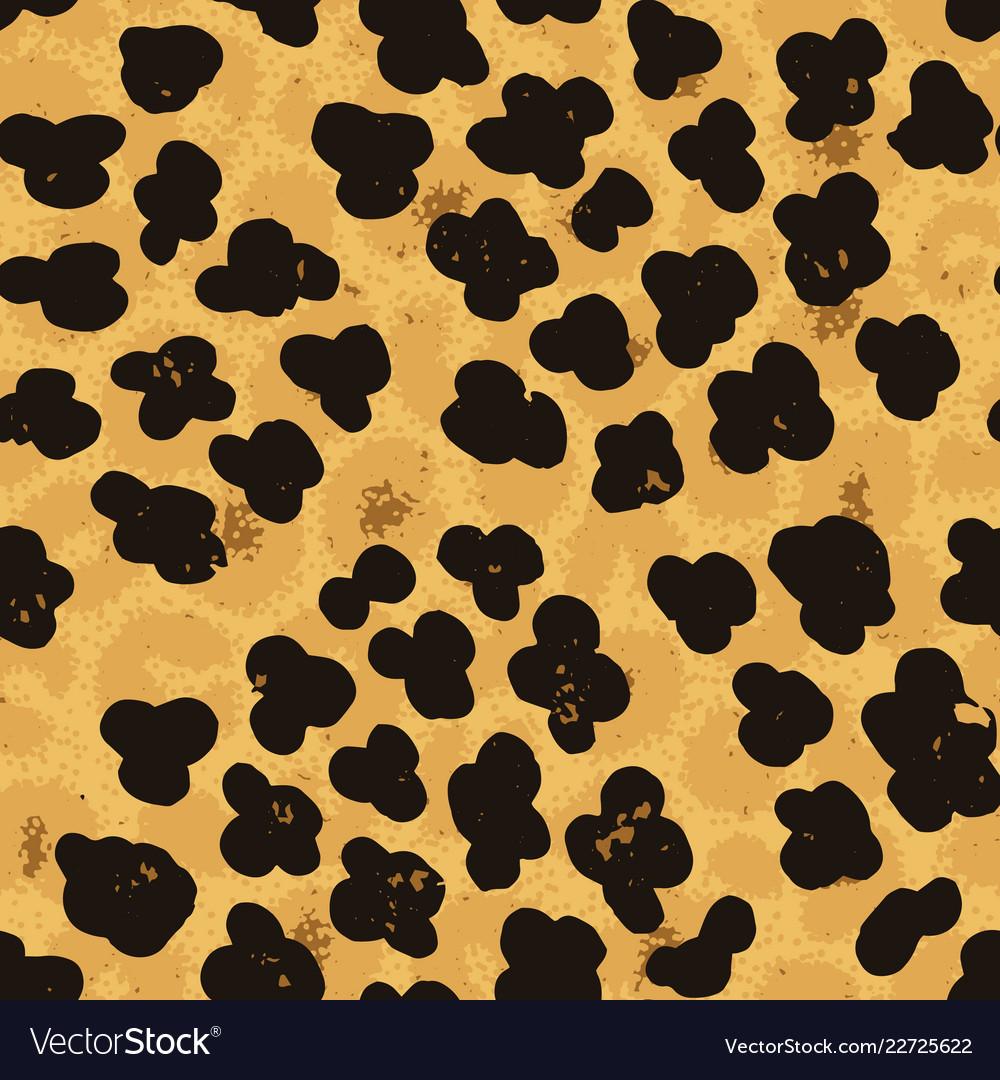 Seamless leopard ocelot or wild cat fur pattern