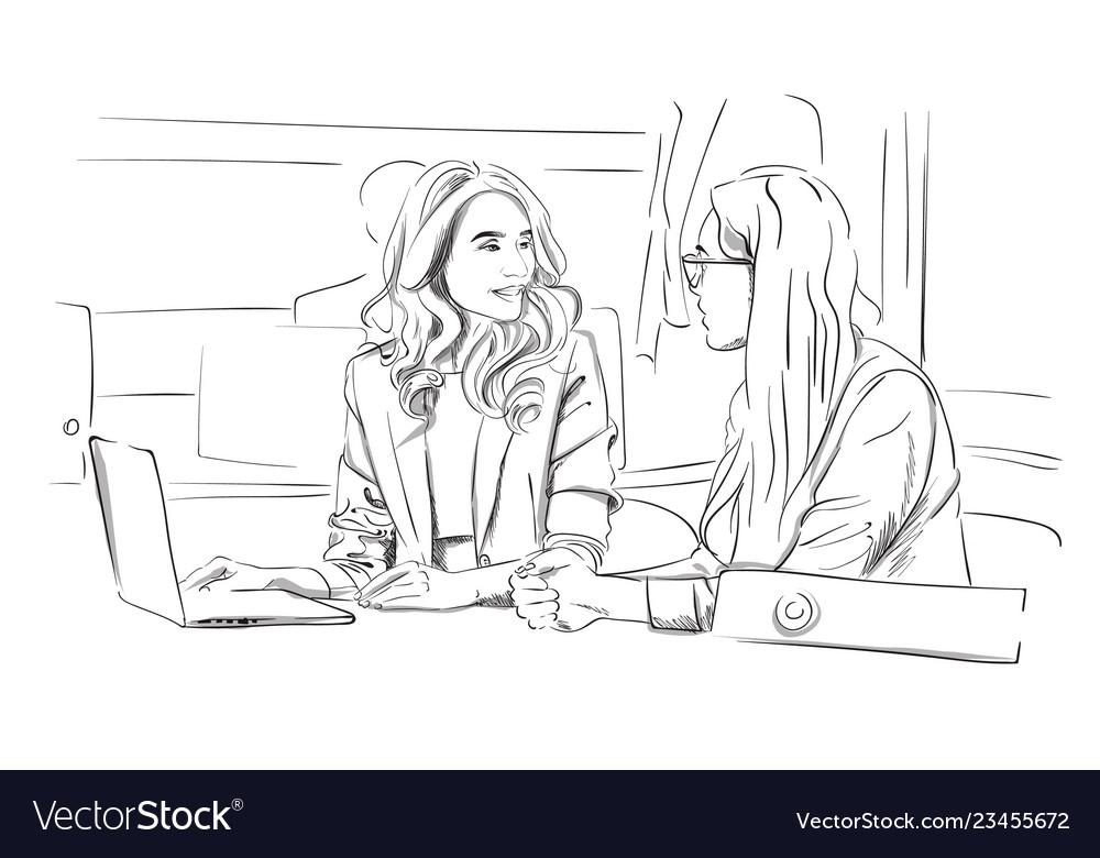 Two business women talking in the office