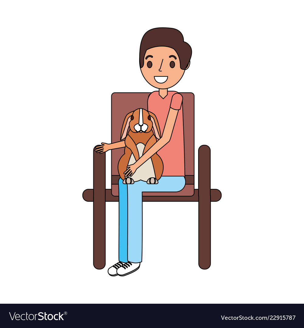 Man with rabbit sitting on chair