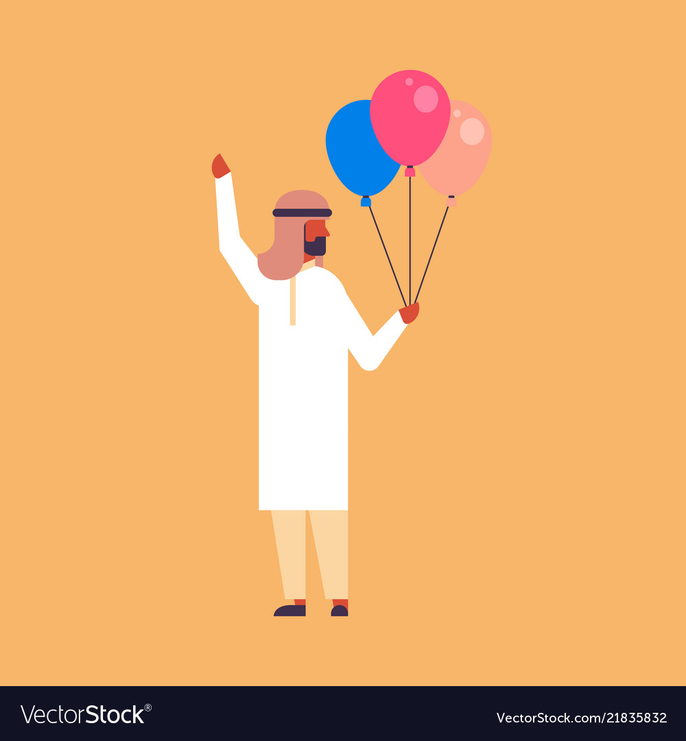 Arabic businessman holding balloons celebrating
