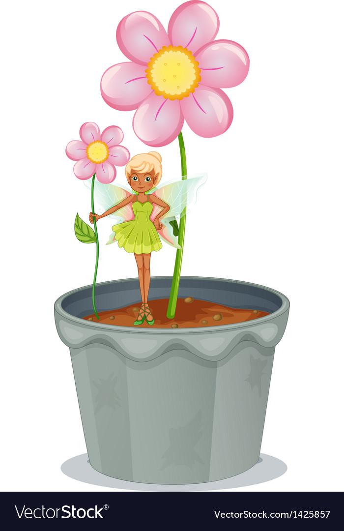 A fairy holding a flower standing on a flower pot
