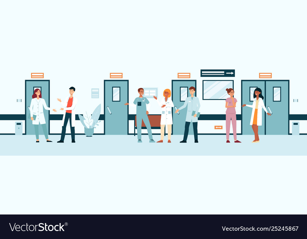 Group doctors and nurses in hospital corridor