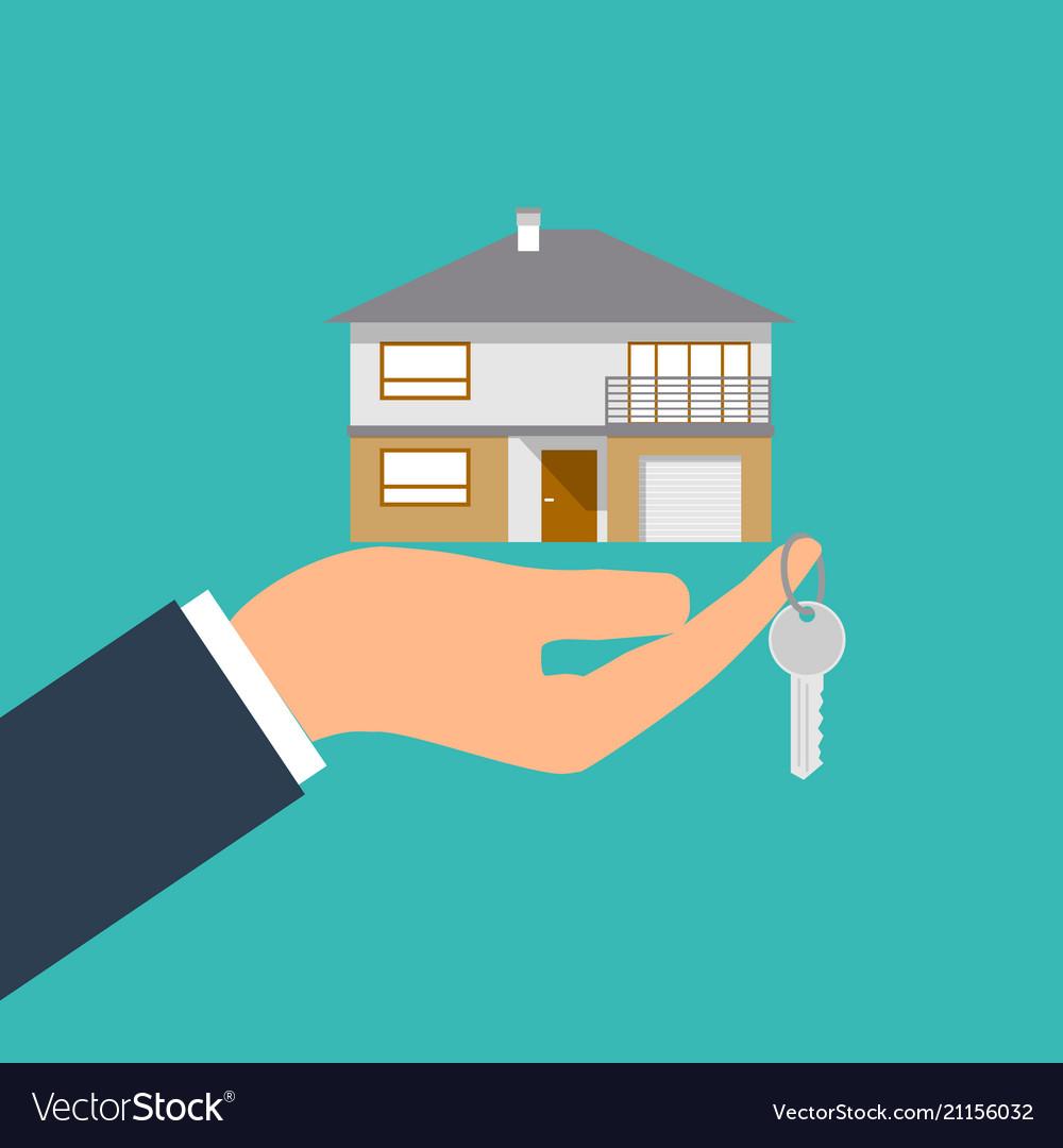 Hand holding house and key image