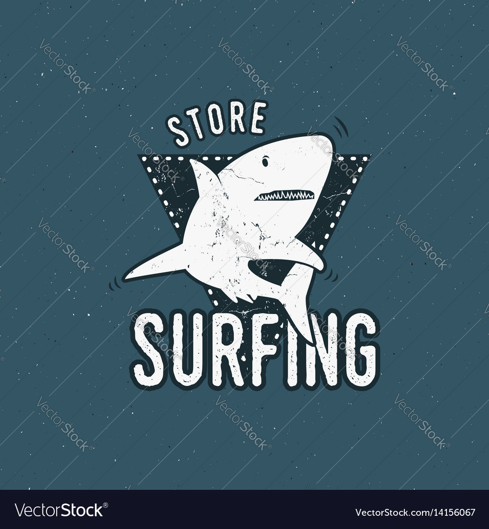 Surfing store emblem design shark on a triangle
