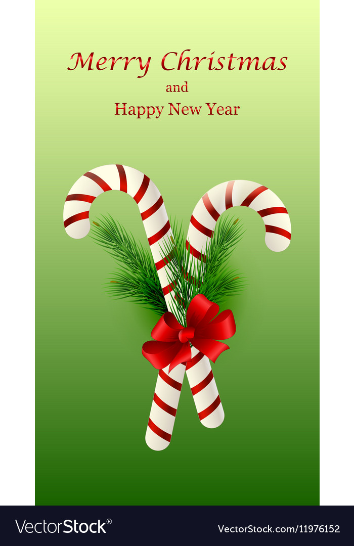 Christmas candy cane decorated with a bow and tree