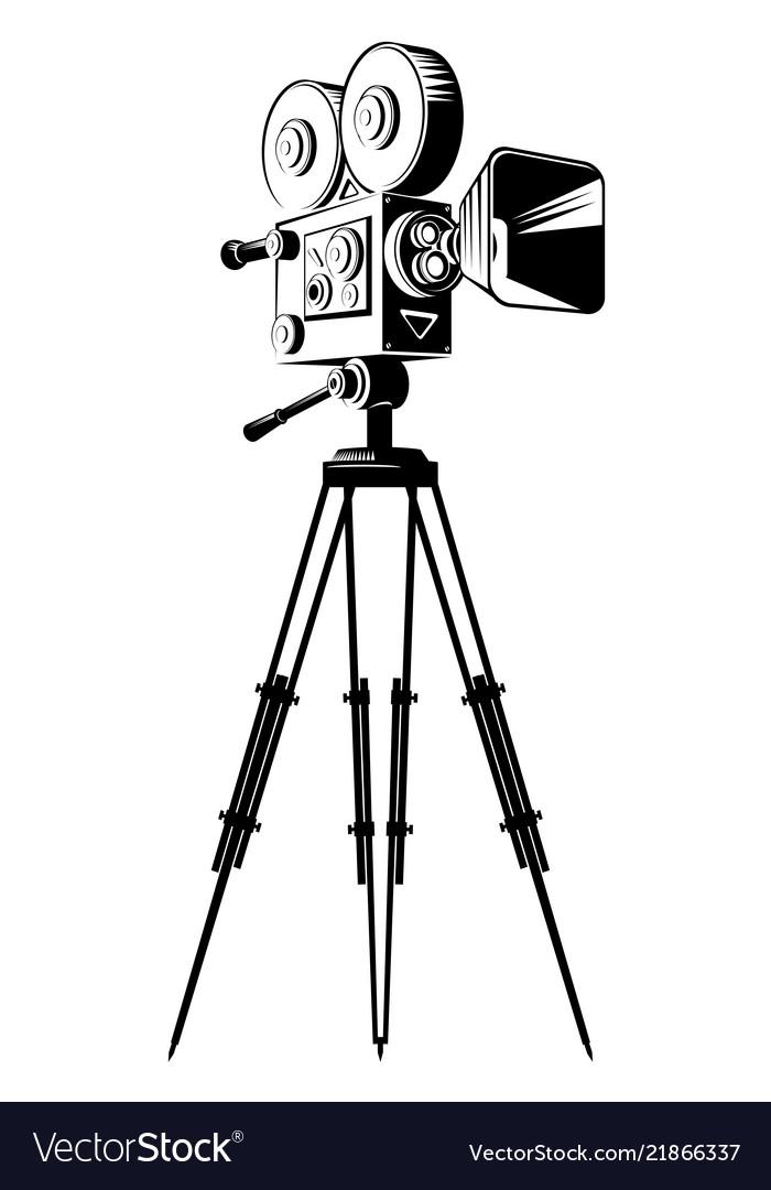 Black retro movie camera on a tripod