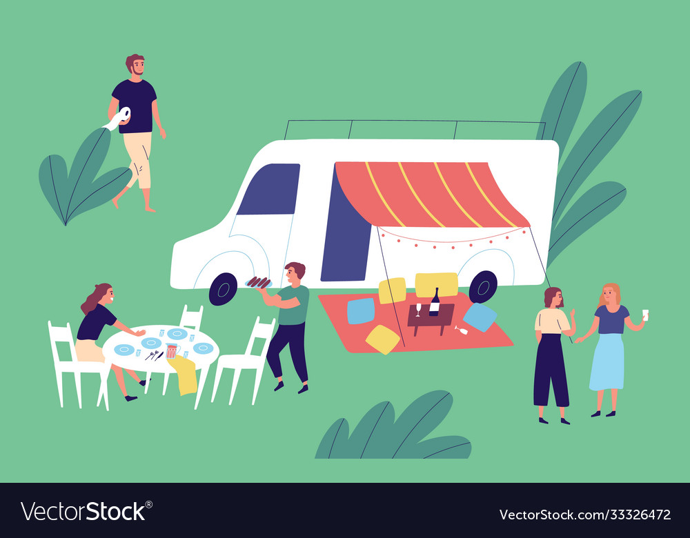 Cheerful friends relaxing together enjoying picnic