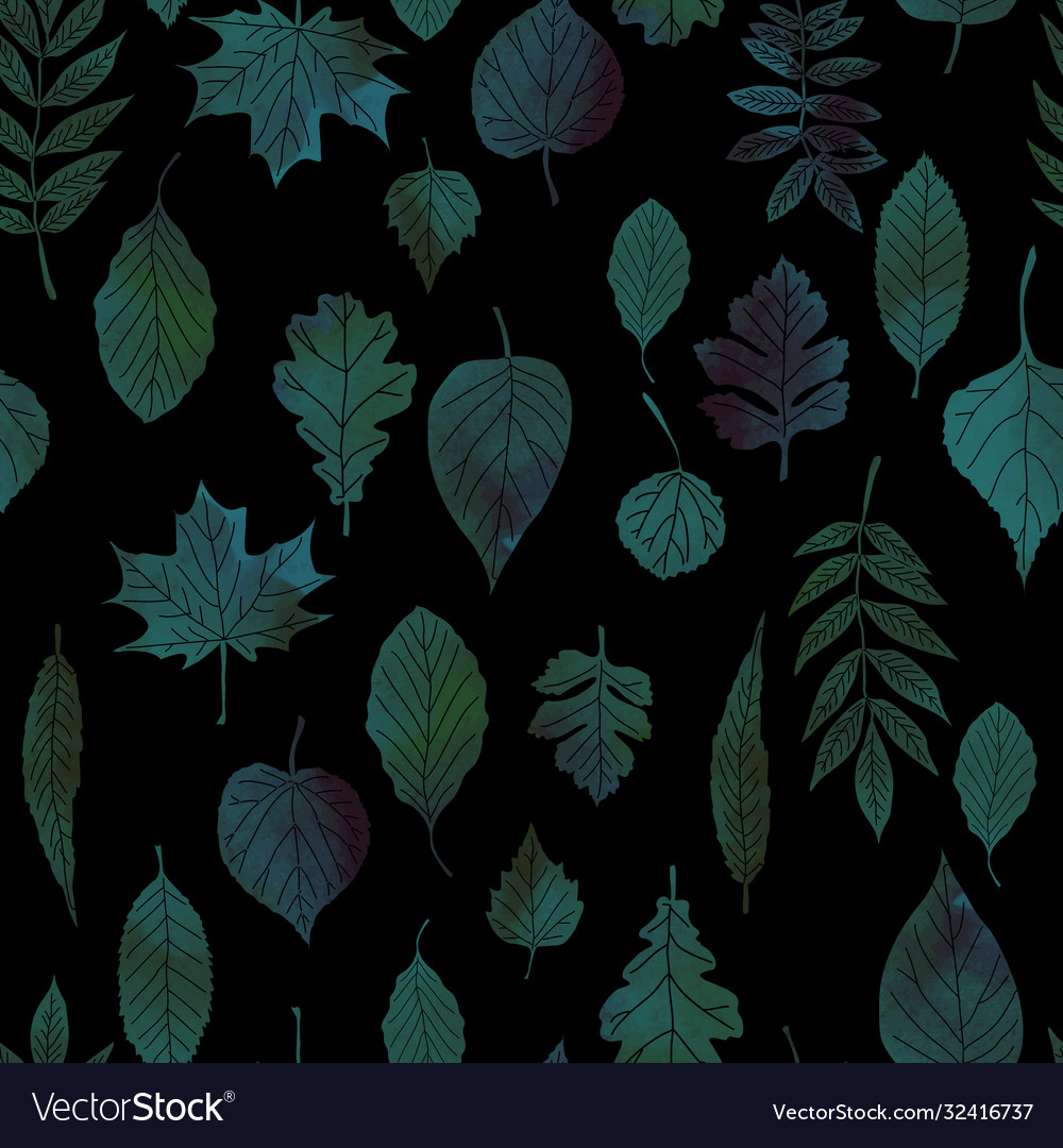 Green leaves on a black background