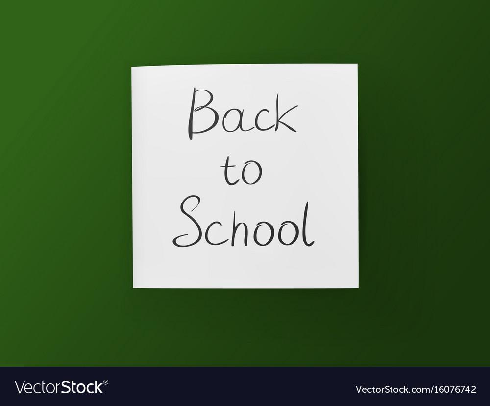 Back to school inscription on white sheet on green