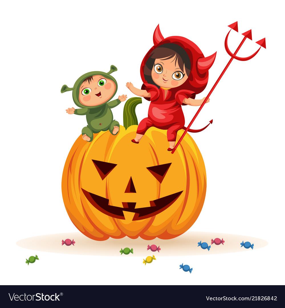 Kids sitting on halloween pumpkin