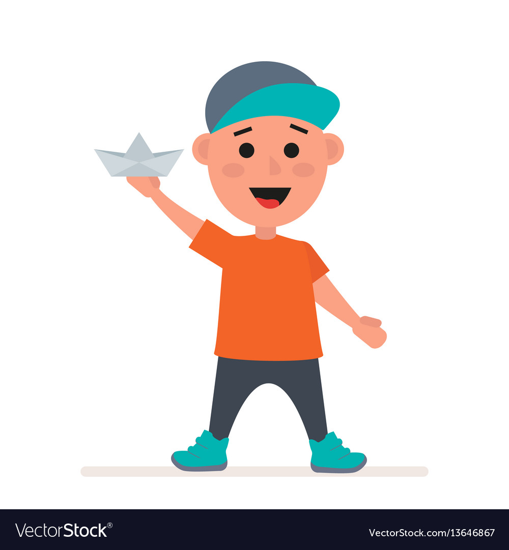 Little boy in a cap with a paper boat in his hands