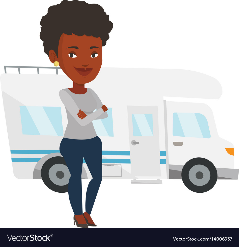 Woman standing in front of motor home