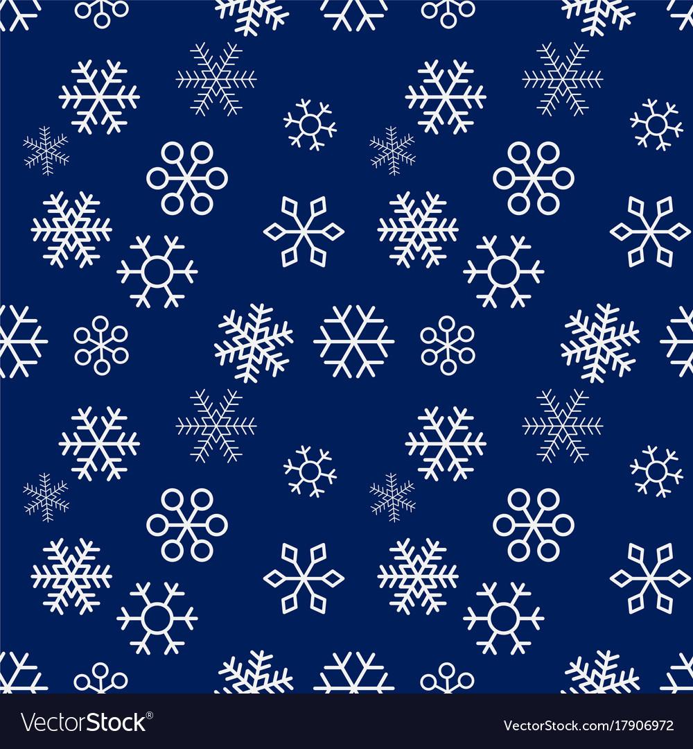 Christmas snowflakes on blue background seamless
