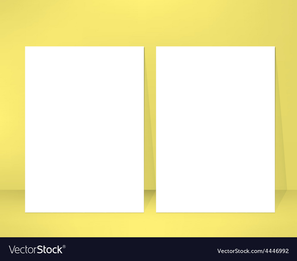 Empty brochure design template leaned against a vector image