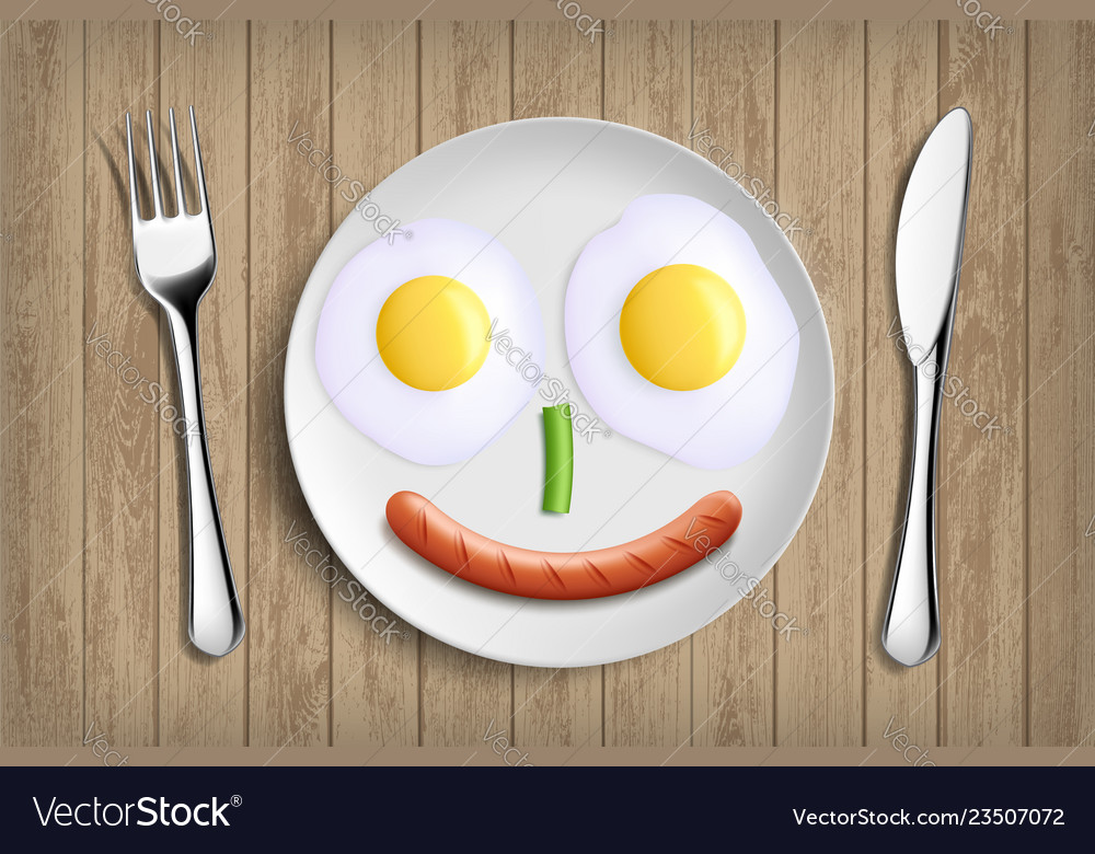 Plate with fried eggs vegetable and sausage like
