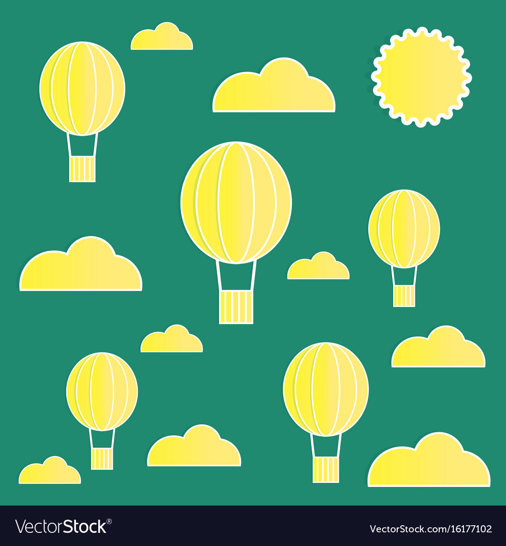 Yellow paper balloons with clouds on green