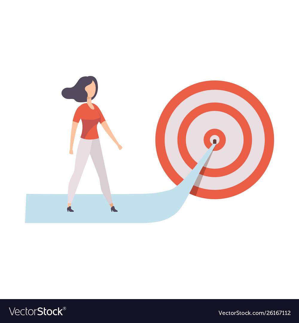 Businesswoman walking to arrow to achieve target