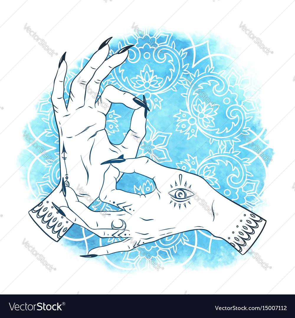 Mudra yoga elegant female hands with boho tattoos