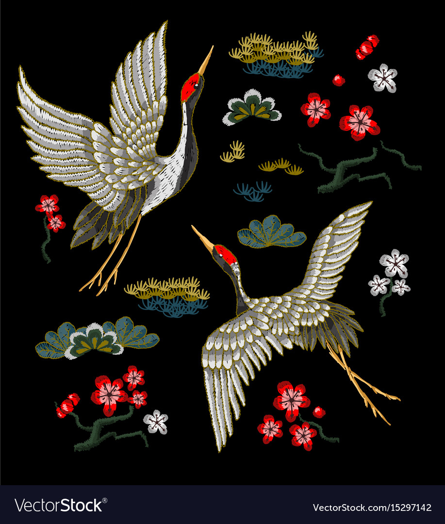 Japanese white cranes with red flowers
