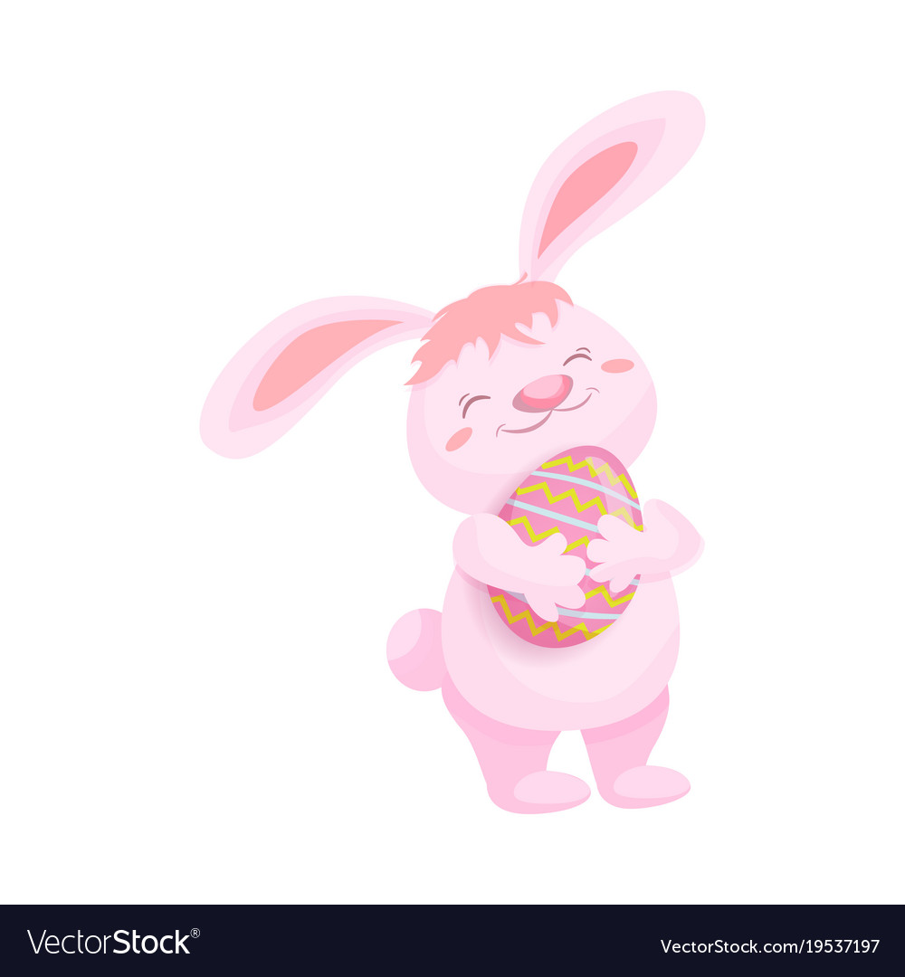 Cute fluffy pink bunny with a painted easter egg