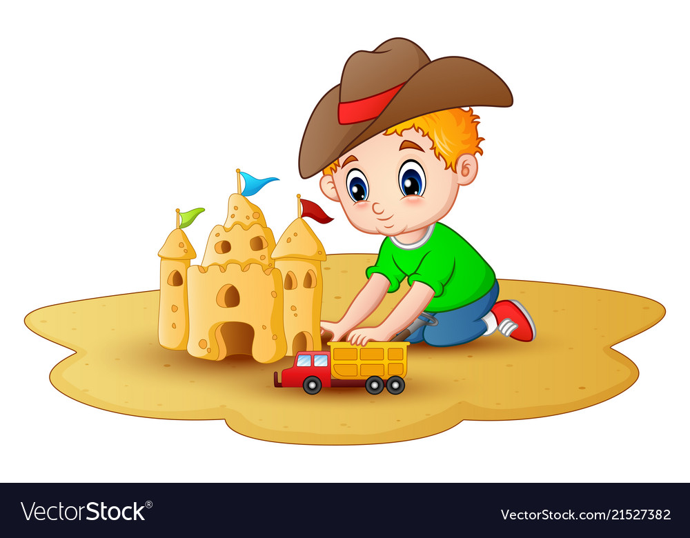 Little boy making a sandcastle with a car toys at