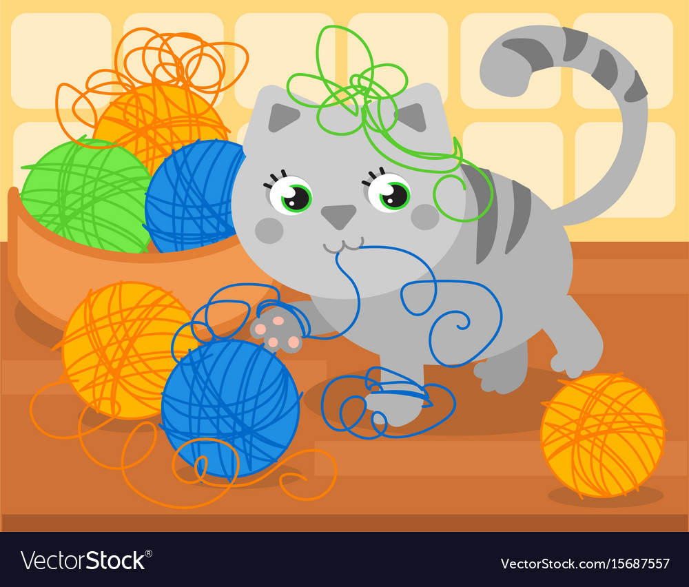 Cute kitty with wool ball