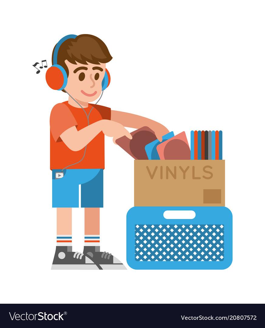 Boy looking old vinyl