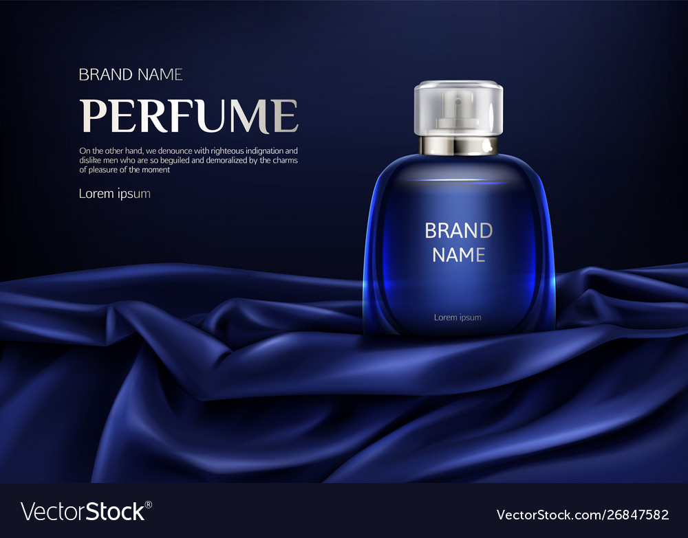 Perfume glass bottle on blue silk folded fabric