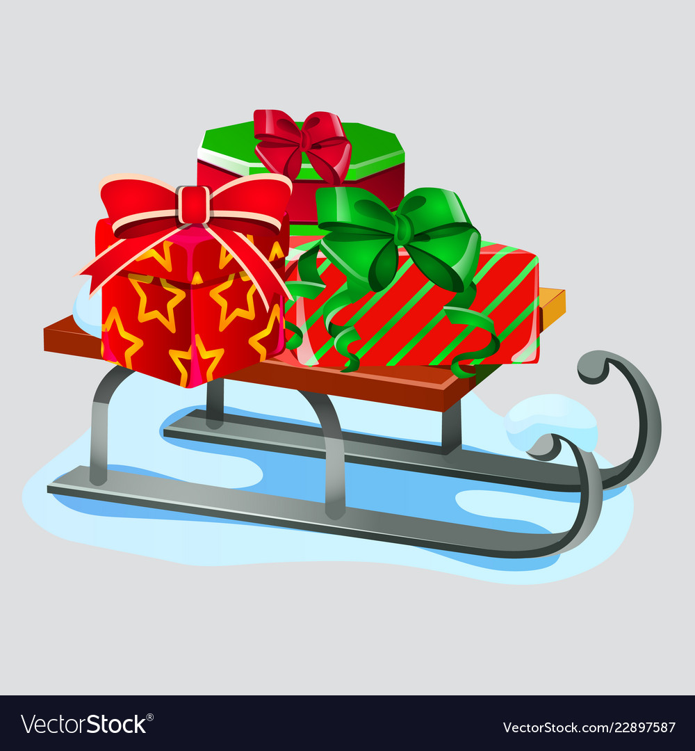 Iron sleigh with festive gift boxes isolated on