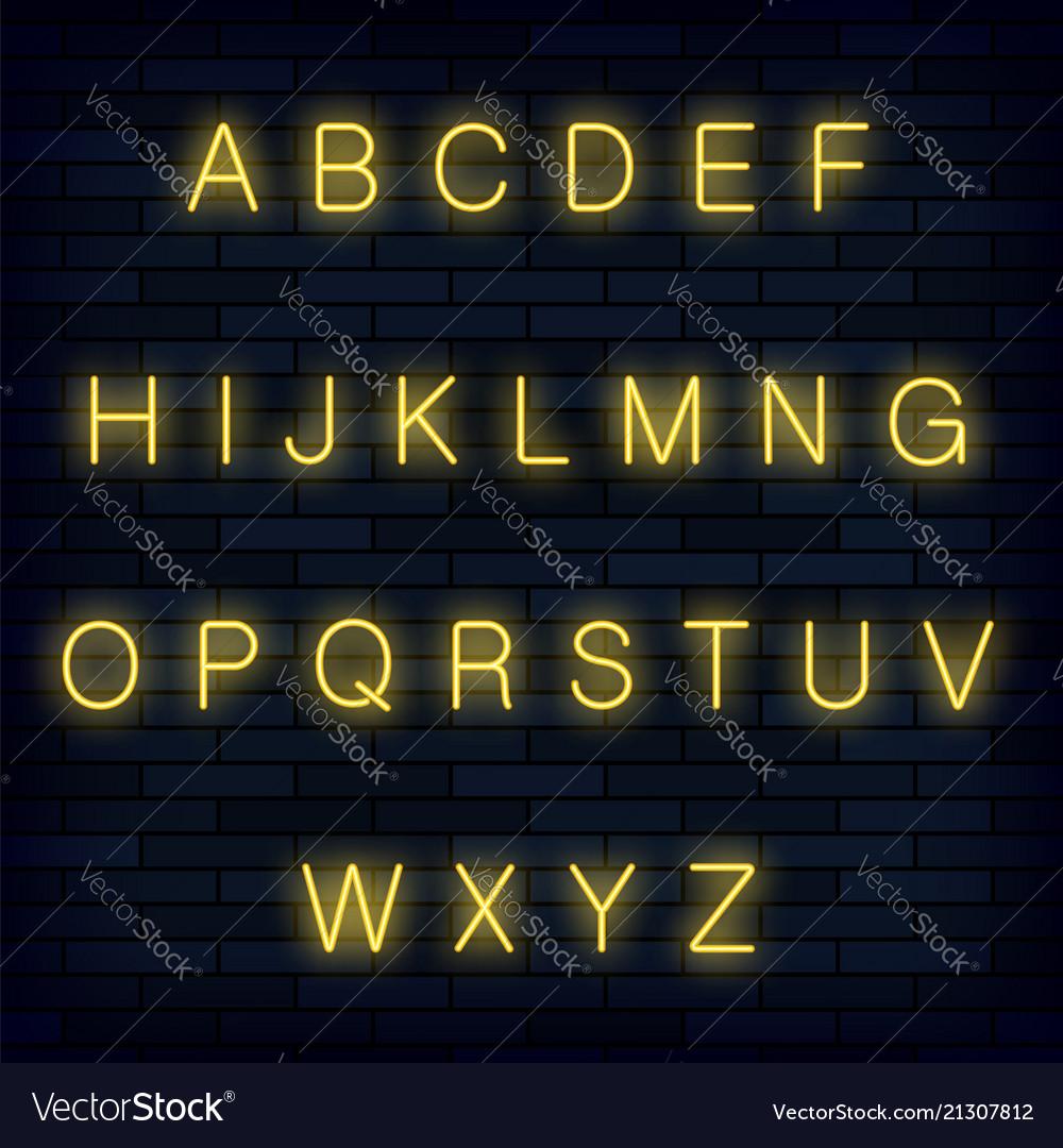 Yellow neon alphabet on blue brick background