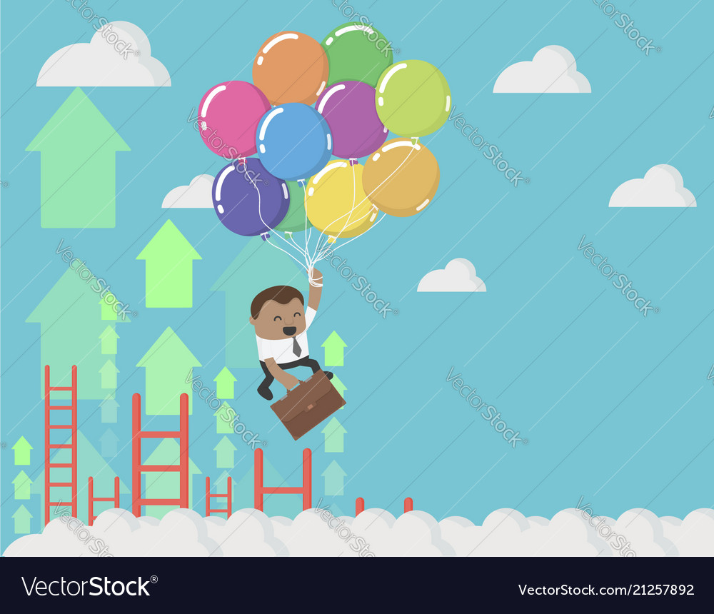 African businessman holding balloons up