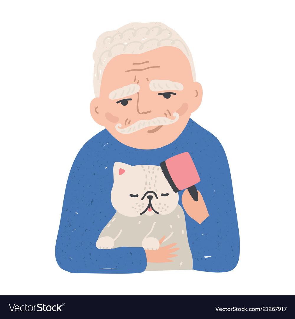 Portrait of elderly man holding his cat or kitten