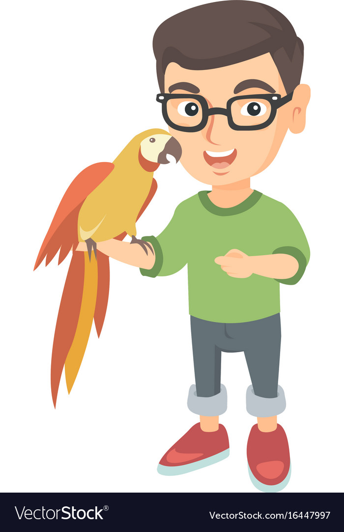 Caucasian little boy holding parrot on his hand