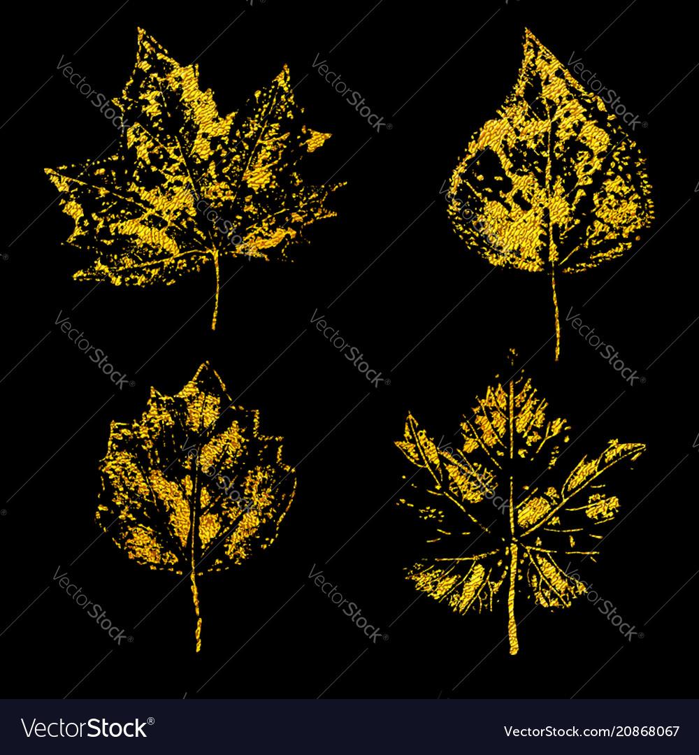Golden leaves on black background