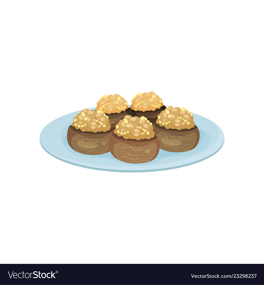 Stuffed mushrooms on blue plate tasty snacks