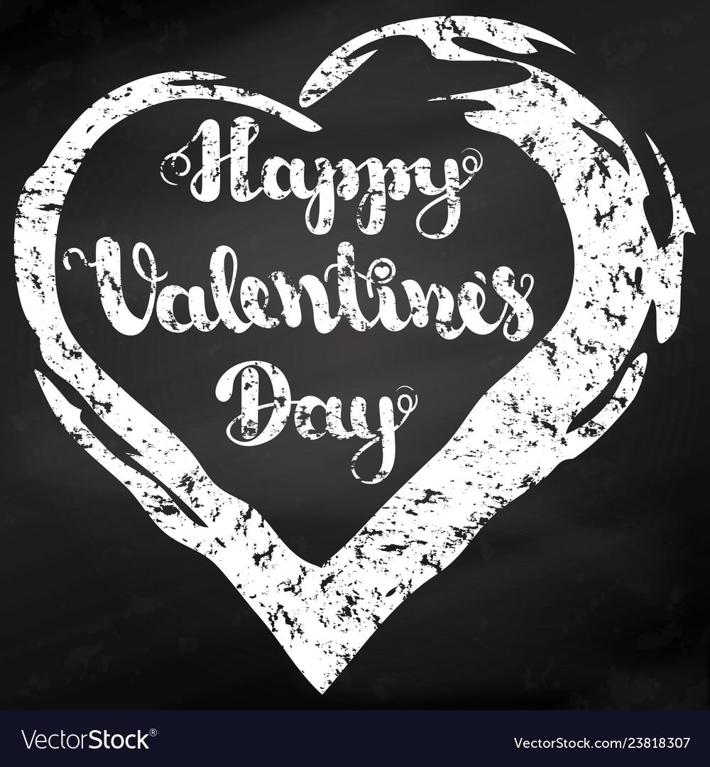 Lettering happy valentines day on black chalkboard