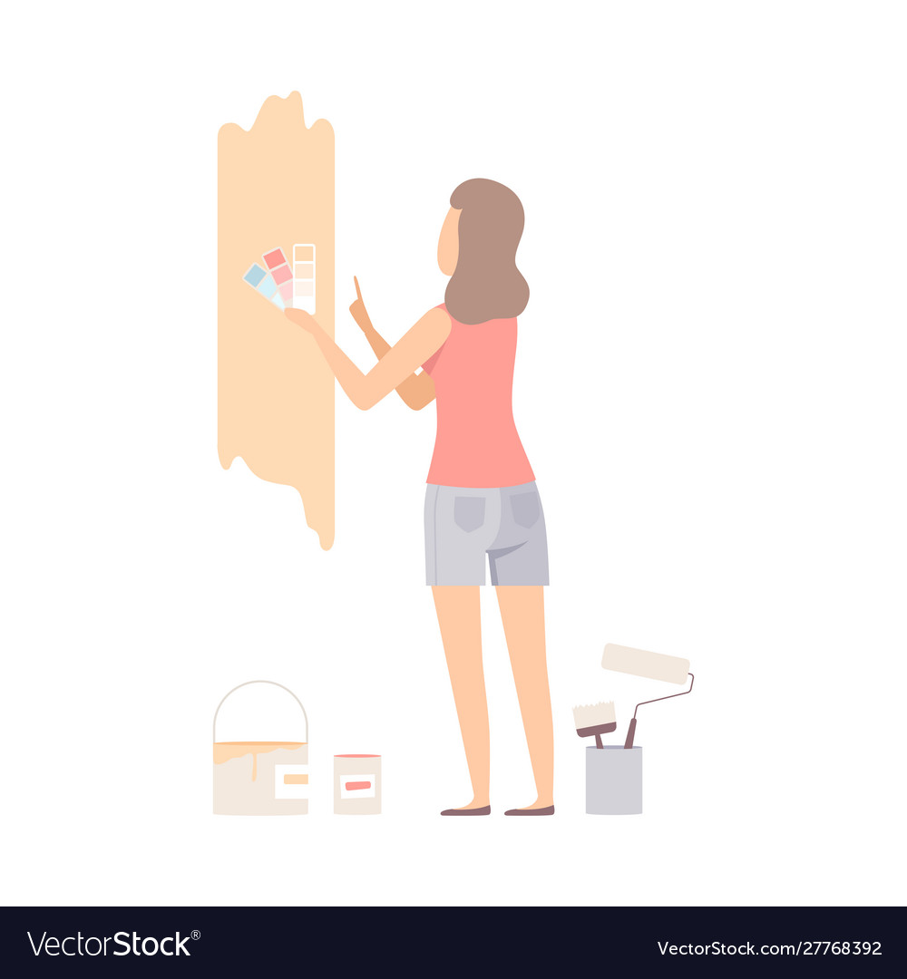 Woman picks color for paint wall with swatches